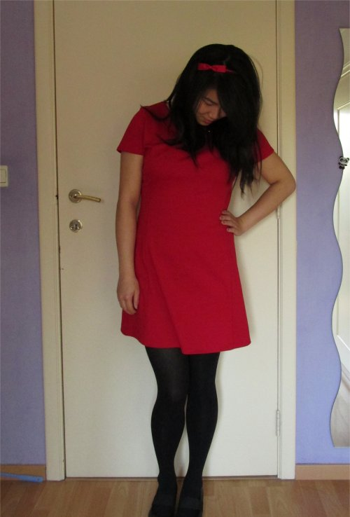 She wore red dresses with her black shining hair.5JPG
