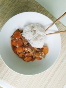 Asian diner of white rice with tofu